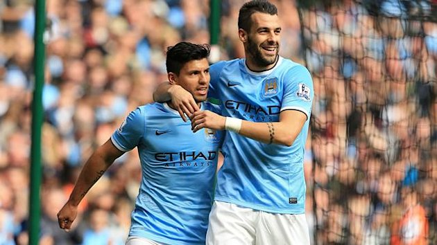 Manchester City's Sergio Aguero (left) celebrates with teammate Alvaro Negredo