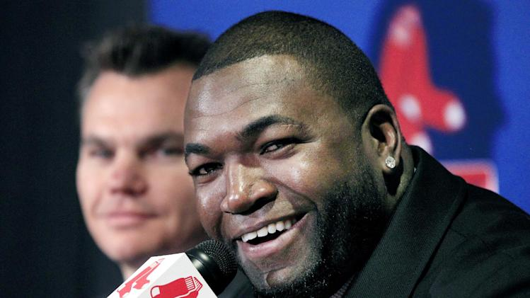 Boston Red Sox's David Ortiz speaks as general manager Ben Cherington, left, listens during a baseball news conference, Monday, Nov. 5, 2012, at Fenway Park in Boston. Ortiz announced that he has finalized a $26 million, two-year contract, which includes bonuses that could raise the value to $30 million. (AP Photo/Elise Amendola)