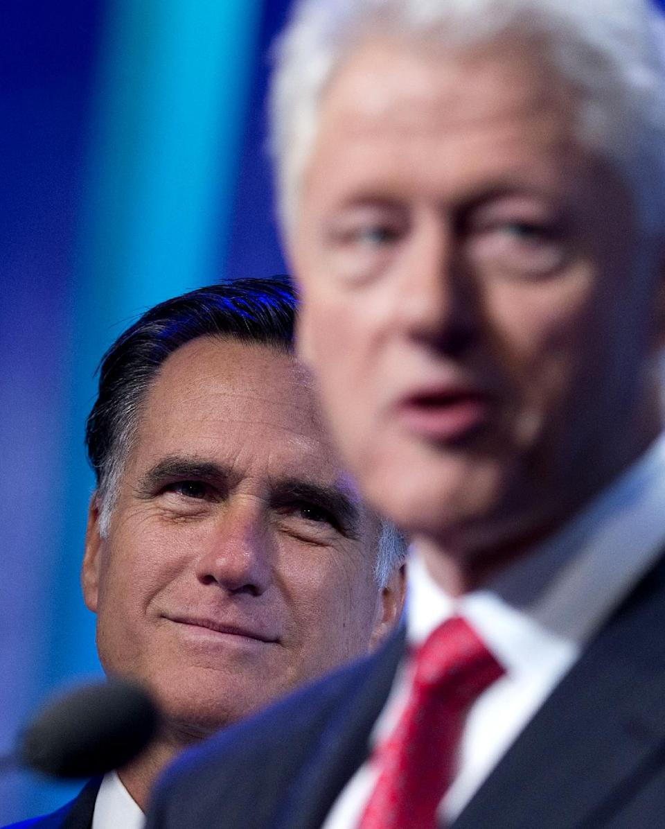 Former President Bill Clinton introduces Republican presidential candidate, former Massachusetts Gov. Mitt Romney at the Clinton Global Initiative convention in New York, Tuesday, Sept. 25, 2012.  (AP Photo/ Evan Vucci)