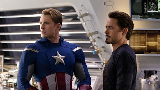 "In this photo provided by Disney, Chris Evans, portraying Captain America, left, and Robert Downey Jr., portraying Tony Stark, act in a scene from ""Marvel's The Avengers."" Facebook fans are getting an early shot to see the all-star superhero tale ""The Avengers."" Disney's Marvel Studios announced Monday, April 2, 2012, that it will offer advance screenings around the world in cities where ""The Avengers"" has gained the most fans on Facebook. (AP Photo/Disney, Zade Rosethal)"