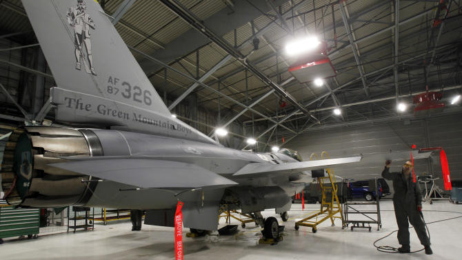In this Monday, Dec. 17, 2012 photo, Master Sgt. Andrew Ehlers does repairs on an F-16 fighter plane in South Burlington, Vt. To people hoping the Air Force will choose Vermont as home to at least 18 F-35 fighter planes, the next-generation aircraft is a source of hundreds of jobs, millions of dollars for the local economy and incalculable state pride. To opponents, the plane is a looming nuisance so much louder than its predecessor, the F-16, it will make life unbearable for people beneath its flight path. The Air Force is nearing its decision about where it will base the planes. (AP Photo/Toby Talbot)