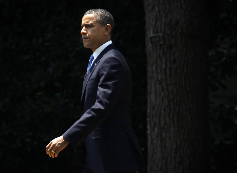 President Barack Obama walks across the South Lawn of the White House in Washington, Thursday, June 28, 2012, before boarding the Marine One helicopter. Obama was traveling to Walter Reed National Medical Center in Bethesda, Md., to visit with members of the military. (AP Photo/Pablo Martinez Monsivais)