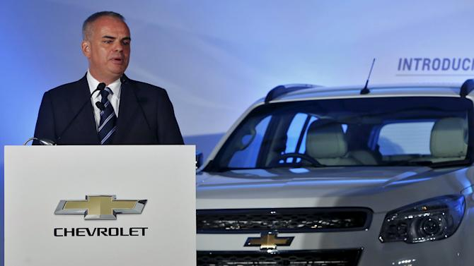 "General Motors Chief of International Operations Jacoby speaks next to the company's ""Trailblazer"" sports-utility vehicle during a news conference in New Delhi"