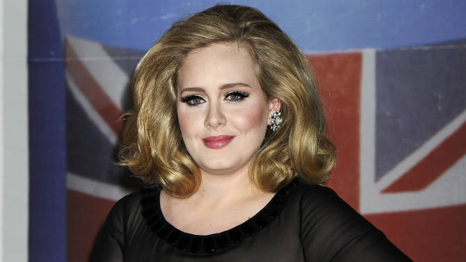 """FILE - In this Feb. 21, 2012 file photo, performer Adele arrives for the Brit Awards 2012 at the O2 Arena in London. The 24-year-old British songstress' album """"21"""" has sold more than 10 million copies, according to Nielsen SoundScan. The album reached the milestone the week of Nov. 19, 2012, less than two years after its release.  Adele rolled so deep in 2012 that she's been voted The Associated Press Entertainer of the Year.  (AP Photo/Jonathan Short, File)"""