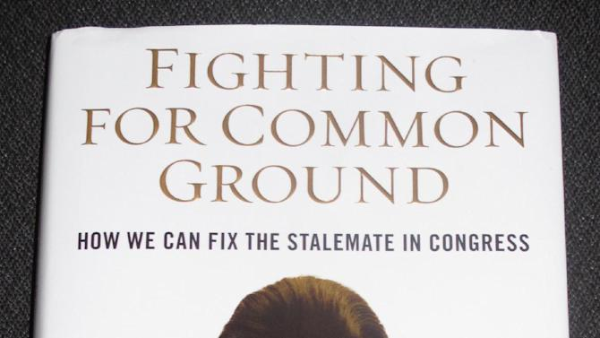 This photograph taken on Saturday, May 11, 2103, in Portland, Maine, shows the cover of former U.S. Sen. Olympia Snowe's new book, which is being released Tuesday. Snowe's book is a call to action to end what she calls excessive partisanship in Congress.  (AP Photo/Clarke Canfield)