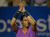 Nadal and Ferrer march on