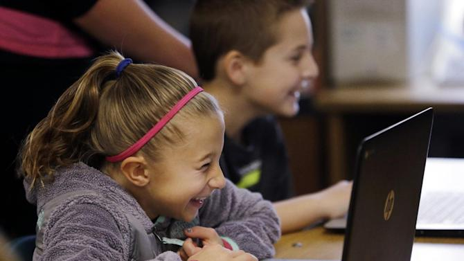 In this photo taken Nov. 4, 2015, fifth grade students work on programming during their weekly computer science lesson at Marshall Elementary School in Marysville, Wash. The school, north of Seattle, joined a growing movement nationwide to expose more public school children to computer science, even as early as in kindergarten. Backed by technology leaders, nonprofits and companies, schools in New York, San Francisco and other cities have committed to offer computer science to students in all grade levels. (AP Photo/Elaine Thompson)