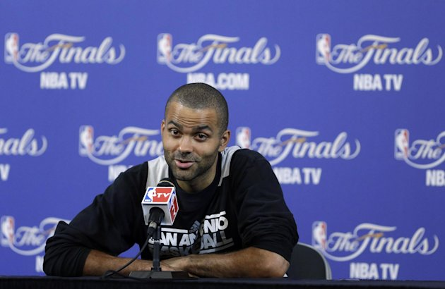 San Antonio Spurs point guard Tony Parker, of France, speaks to members of the media during a news conference after NBA basketball practice, Wednesday, June 19, 2013, at the American Airlines Arena in