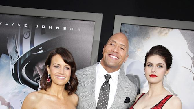"Carla Gugino, Dwayne Johnson and Alexandra Daddario seen at New Line Cinema presents the Los Angeles World Premiere of ""San Andreas"" at TCL Chinese Theatre on Tuesday, May 26, 2015, in Hollywood, CA. (Photo by Eric Charbonneau/Invision for Warner Bros./AP Images)"