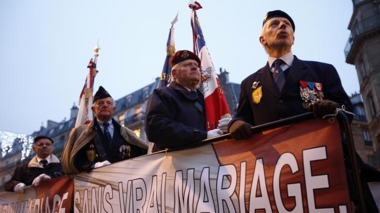"War veterans demonstrate with the fundamentalist Catholic group Civitas with a poster reading ""Without true marriage, no more, no more nation"" in Paris, Sunday, Jan. 13, 2013. Hundreds of thousands of protesters are mobilizing against the French president's plan to legalize gay marriage, streaming into Paris by bus, car and specially reserved high-speed train. Police are expecting about 300,000 people to march toward the Eiffel Tower from three different points in the city, tying up traffic and closing subway stations for hours in what could be the largest demonstration in a decade. (AP Photo/Michel Spingler)"