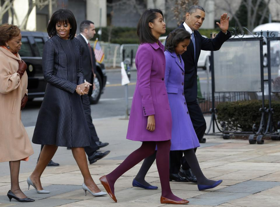 President Barack Obama, waves as he walks with his daughters Sasha and Malia, first lady Michelle Obama and mother-in-law Marian Robinson, to St. John's Church in Washington, Monday, Jan. 21, 2013, for a church service during the 57th Presidential Inauguration. (AP Photo/Jacquelyn Martin)
