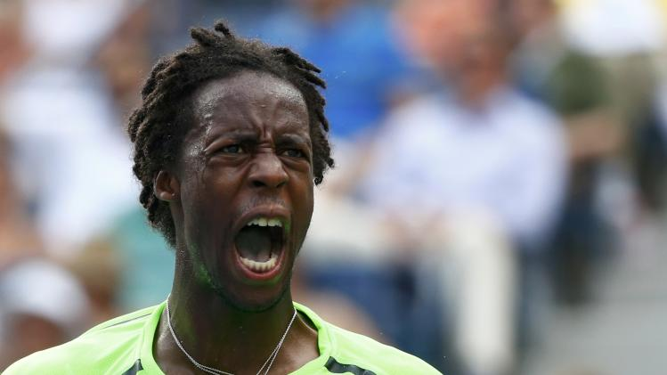 Monfils of France disagrees with a call during his fourth round match against Dimitrov of Bulgaria at the 2014 U.S. Open tennis tournament in New York