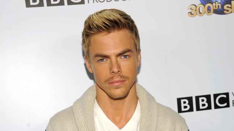 FILE - This May 14, 2013 file photo shows professional dancer Derek Hough poses at the Dancing With The Stars 300th episode celebration at Boulevard 3 in Los Angeles. Hough has won the mirror-ball trophy three times since he joined the show in 2007. (Photo by Chris Pizzello/Invision/AP, file)