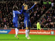 Fernando Torres, right, is smiling again after scoring four times in Rafael Benitez's first two wins in charge