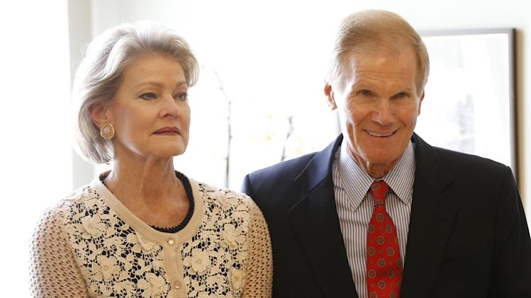 U.S. Sen. Bill Nelson, D-Fla., right, and his wife Grace Nelson seen prior to his meeting with Lithuania's President Dalia Grybauskaite, unseen, in the President palace in Vilnius, Lithuania, Friday, Aug. 22, 2014. (AP Photo/Mindaugas Kulbis)