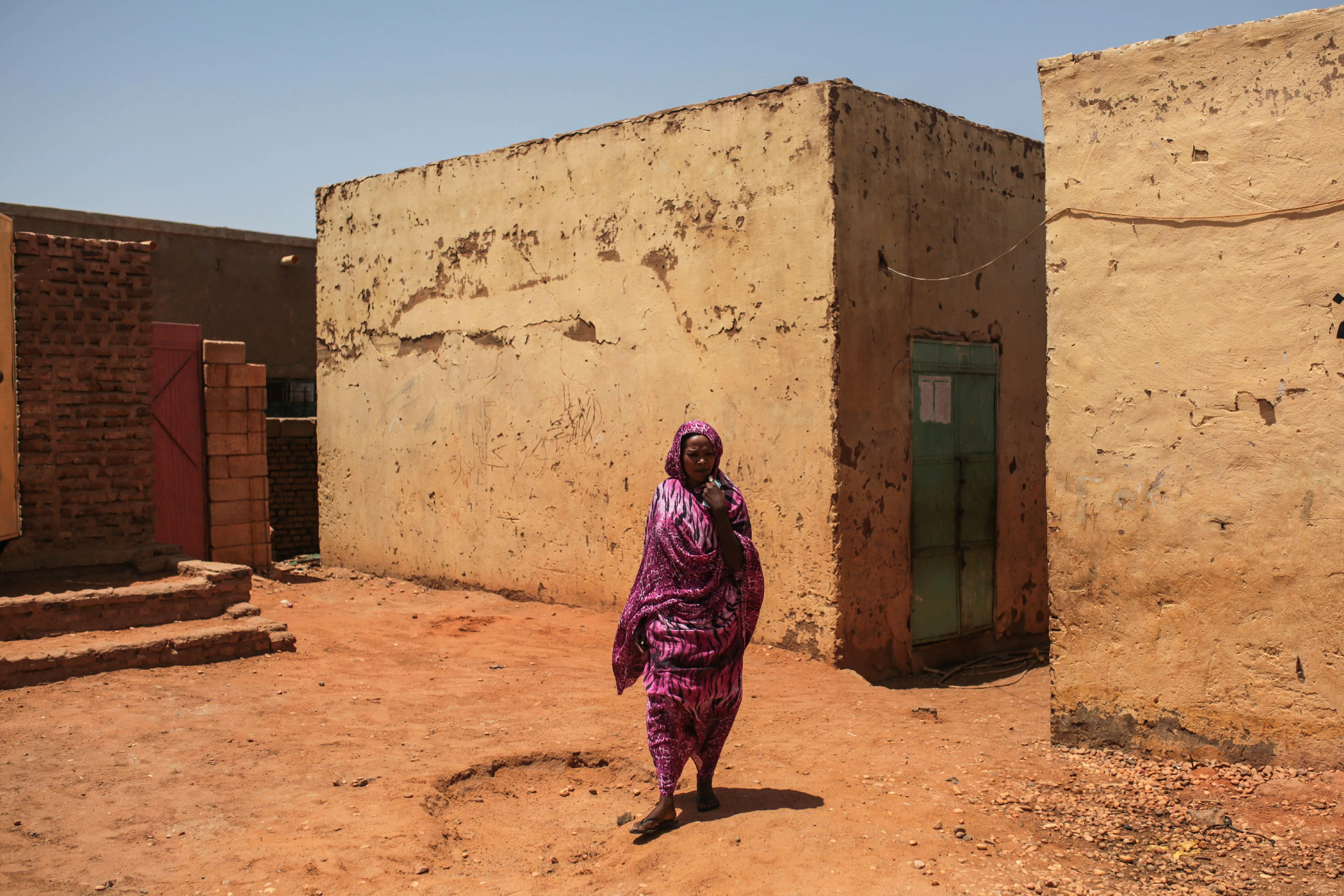 In Sudan, poverty, heavy security grip under longtime leader