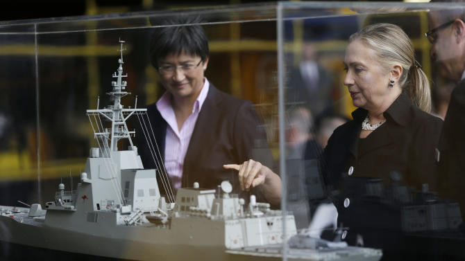 Australian Finance Minister Penny Wong, left, and U.S. Secretary of State Hillary Rodham Clinton view a model during a tour of the Techport Australia shipbuilding facility near Adelaide, Australia Thursday, Nov. 15, 2012. (AP Photo/Matt Rourke, Pool)