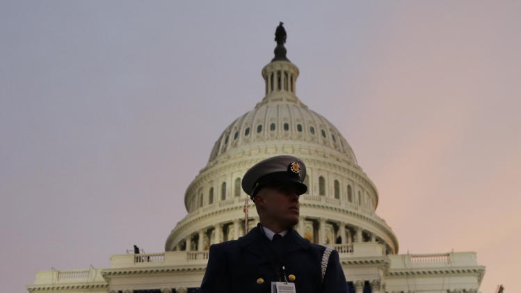 A ceremonial Coast Guard honor guard stands in front of the U.S. Capitol before the ceremonial swearing-in of President Barack Obama during the 57th Presidential Inauguration in Washington, Monday, Jan. 21, 2013. (AP Photo/Evan Vucci)