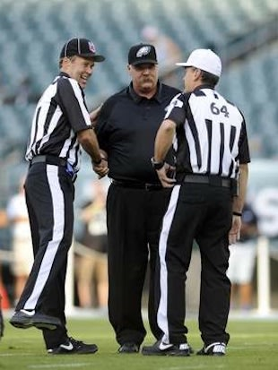 Replacement refs speak with Eagles coach Andy Reid before a game Wayne Bernier also worked — AP