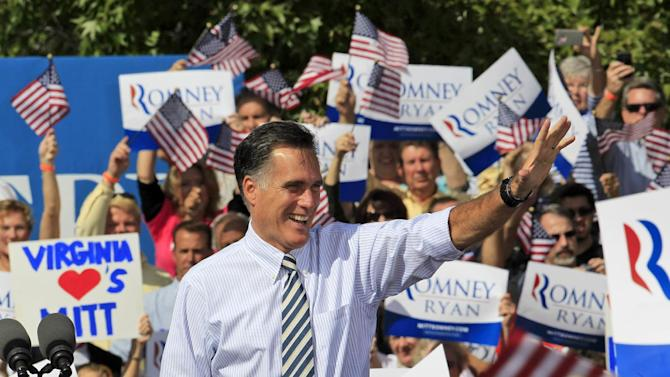 Republican presidential candidate, former Gov. Mitt Romney waves to supporters as he arrives for a rally at Tidewater Community College in Chesapeake, Va., Wednesday, Oct. 17, 2012. (AP Photo/Steve Helber)