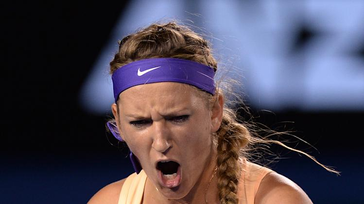 Victoria Azarenka of Belarus reacts in her match against China's Li Na during the women's final at the Australian Open tennis championship in Melbourne, Australia, Saturday, Jan. 26, 2013. (AP Photo/Andrew Brownbill)