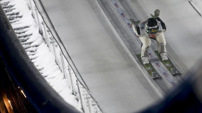 Prevz from Slovenia speeds down the ski jump during the trial round for the first jumping of the 63rd four-hills ski jumping tournament in Oberstdorf
