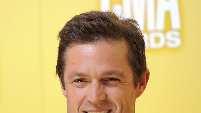 Eric Close arrives at the 46th Annual Country Music Awards at the Bridgestone Arena on Thursday, Nov. 1, 2012, in Nashville, Tenn. (Photo by Chris Pizzello/Invision/AP)