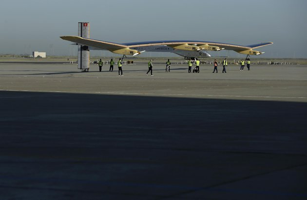 The Solar Impulse is seen after landing from a test flight at Moffett Field NASA Ames Research Center in Mountain View, Calif., Friday, April 19, 2013. A solar-powered plane that has wowed aviation fans in Europe is set to take an early morning test flight over the San Francisco Bay area. Considered the world's most advanced sun-powered plane, the Solar Impulse is set to take off from Moffett Field in Mountain View at first light for a two-hour practice run leading up to the start of a multi-city, cross-country tour. (AP Photo/Jeff Chiu)