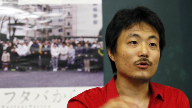 """In this photo taken Sept. 11, 2012, Atsushi Funahashi, director of the film """"Nuclear Nation,"""" speaks during an interview in Tokyo Tuesday, Sept. 11, 2012. His film documented a story of the residents of Futaba, Fukushima prefecture, the town where the tsunami crippled Fukushima Dai-ichi nuclear power plant is located. The March 2011 catastrophe in Japan has set off a flurry of independent films telling the stories of regular people who became overnight victims, stories the creators feel are being ignored by mainstream media and often silenced by the authorities. Nearly two years after the quake and tsunami disaster, the films are an attempt by the creative minds of Japan's movie industry not only to confront the horrors of the worst nuclear disaster since Chernobyl, but also as a legacy and to empower the victims by telling their story for international audiences. (AP Photo/Koji Sasahara)"""