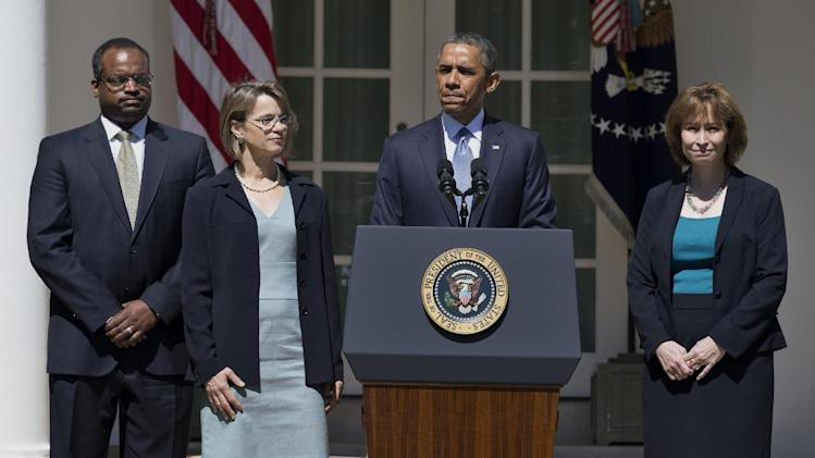 FILE - This June 4, 2013 file photo shows President Barack Obama pausing as he speaks in the Rose Garden of the White House in Washington where he announced the nominations of, from left, Robert Wilkins, Cornelia Pillard, and Patricia Ann Millet, to the U.S. Court of Appeals for the District of Columbia Circuit. Democrats begin a drive this week to muscle a half dozen of President Barrack Obama's Republican-opposed nominees through the Senate after clamping shackles on traditional minority party rights in last month's power play against the GOP. Republicans, however, still have some tools for grinding the Senate's work to an excruciatingly slow crawl. (AP Photo/Manuel Balce Ceneta, File)