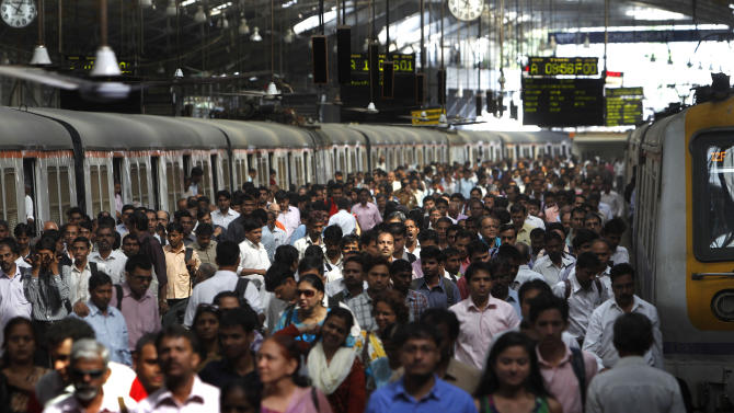"FILE - In this Tuesday, Oct. 25, 2011 photo, commuters disembark from trains at a train station in Mumbai. India's population is expected to surpass China's around 2028 when both countries will have populations of around 1.45 billion, according to the report Thursday, June 13, 2013, on ""World Population Prospects."" While India's population is forecast to grow to around 1.6 billion and then slowly decline to 1.5 billion in 2100, China's is expected to start decreasing after 2030, possibly falling to 1.1 billion in 2100, it said. (AP Photo/Rafiq Maqbool, File)"