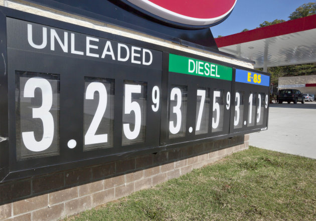 In this Tuesday, Oct. 30, 2012, photo, lower fuel prices are advertised at North Little Rock, Ark., gas station. Wholesale prices fell in October as a big drop in gasoline and other energy prices offs