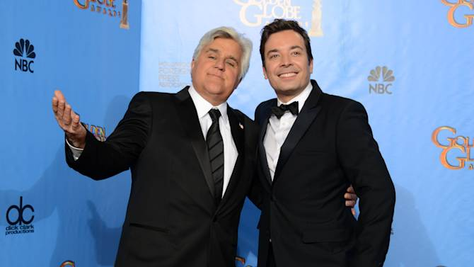 "FILE - This Jan. 13, 2013 file photo shows Jay Leno, host of ""The Tonight Show with Jay Leno,"" left, and Jimmy Fallon, host of ""Late Night with Jimmy Fallon"" backstage at the 70th Annual Golden Globe Awards in Beverly Hills, Calif. NBC announced Wednesday, April 3, 2013 that Jimmy Fallon is replacing Jay Leno as the host of ""The Tonight Show"" in spring 2014. (Photo by Jordan Strauss/Invision/AP, file)"