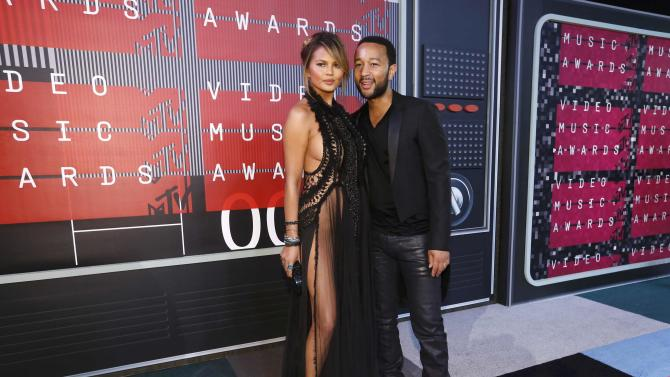 Model Chrissy Teigen and her husband, musician John Legend, arrive at the 2015 MTV Video Music Awards in Los Angeles