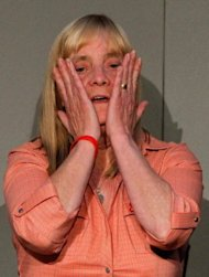 "Hillsborough Family Support Group member Margaret Aspinall, the mother of Hillsborough victim James Aspinall, reacts during a press conference at Liverpool's Anglican Cathedral on September 12. Prime Minister David Cameron apologised Wednesday to the families of the 96 victims of the 1989 Hillsborough football stadium disaster for the ""double injustice"" they suffered"