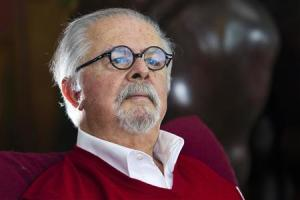 Colombian figurative artist Botero poses for a picture during an interview with Reuters in his New York apartment