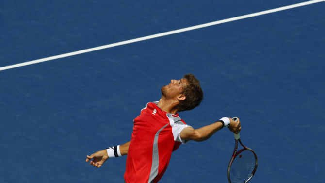 Slovakia's Martin Klizan serves to France's Jo-Wilfried Tsonga in the second round of play at the 2012 US Open tennis tournament,  Thursday, Aug. 30, 2012, in New York. Fifth-seeded Jo-Wilfried Tsonga was upset by Klizan in the second round.  (AP Photo/Paul Bereswill)