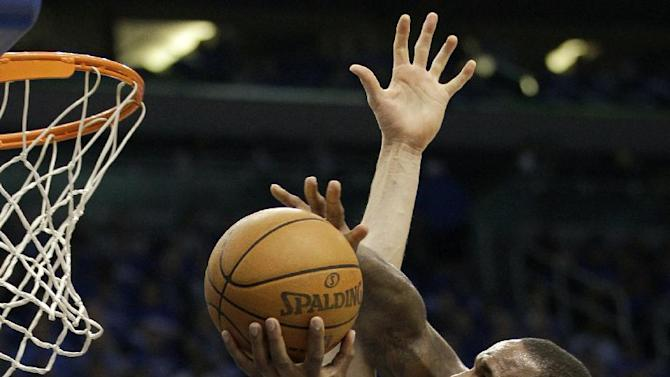 Orlando Magic's Glen Davis, right, makes a shot past Indiana Pacers' Louis Amundson (17) during the first half of Game 3 of an NBA first-round playoff basketball series, Wednesday, May 2, 2012, in Orlando, Fla. (AP Photo/John Raoux)