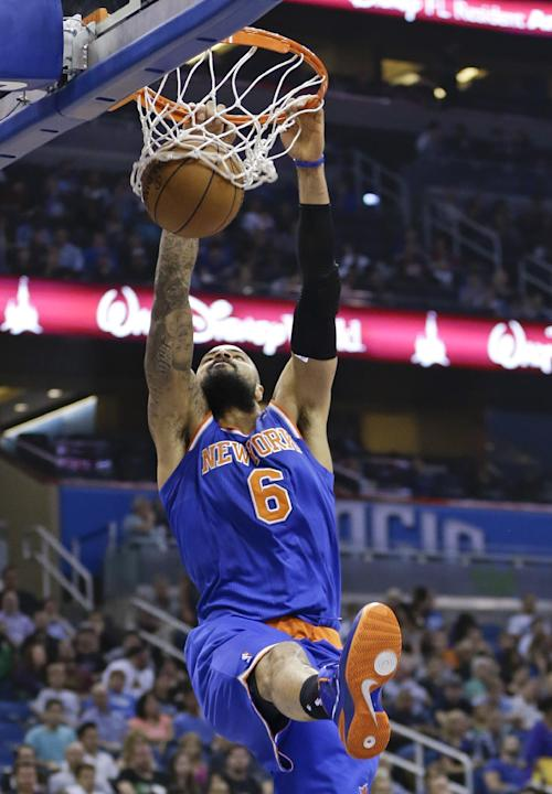 New York Knicks' Tyson Chandler (6) makes an uncontested dunk against the Orlando Magic in the first half of an NBA basketball game in Orlando, Fla., Monday, Dec. 23, 2013
