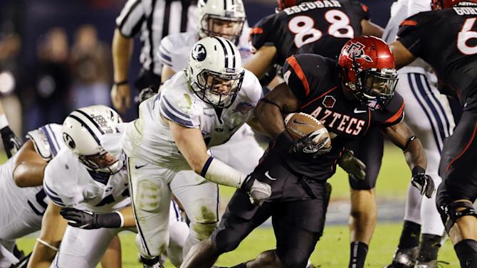 San Diego State running back Adam Muema rushes against BYU for a first down during the first half of the Poinsettia Bowl NCAA college football game, Thursday, Dec. 20, 2012, in San Diego. (AP Photo/Lenny Ignelzi)