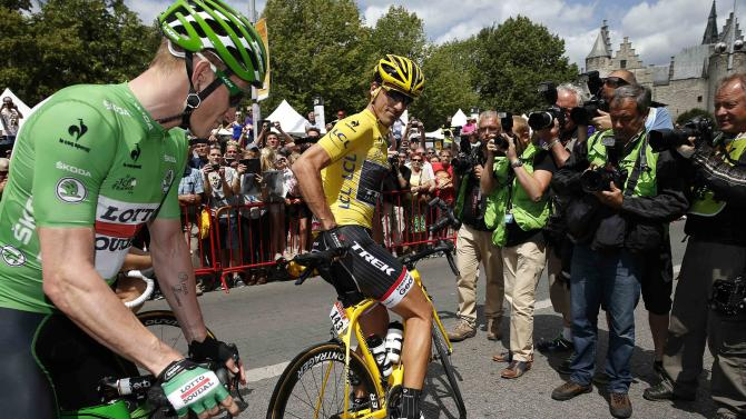 Trek Factory rider Fabian Cancellara of Switzerland, race leader and yellow jersey holder, stands next to sprinter green jersey holder Lotto-Soudal rider Andre Greipel of Germany before the start of the third stage of the 102nd Tour de France cycling race