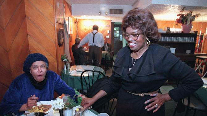 """FILE- In this Jan. 17, 1996 file photo, the Self-described """"Queen of Soul Food"""" Sylvia Woods, right, greets patron Carrie Haynes-Madsen at her restaurant, """"Sylvia's,"""" in the Harlem neighborhood of New York. Wood died in Mount Vernon, N.Y. on Thursday, July 19, 2012. She was 86. (AP Photo/Kathy Willens, File)"""
