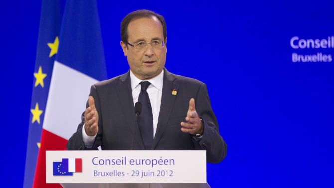 French President Francois Hollande gestures while speaking during a media conference at an EU Summit in Brussels on Friday, June 29, 2012. European leaders have agreed to use the continent's permanent bailout fund to recapitalize struggling banks, and agreed to the idea of a tighter union in the long term. (AP Photo/Michel Euler)