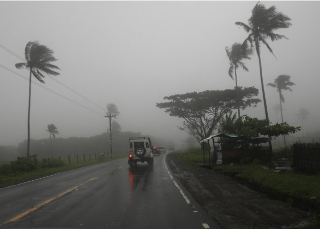 Motorists drive on a highway in Batangas, south of Manila, Philippines, under a dense fog and rain brought about by typhoon Nanmadol Saturday, Aug. 27, 2011. The slow-moving typhoon made landfall in t