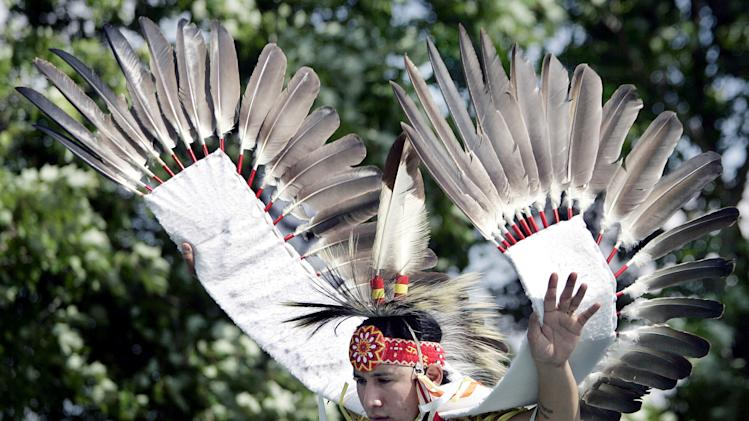 FILE - In this May 27, 2006 file photo, Joseph Bearstail. a member of the Sioux tribe from Preston, Conn., wears a costume with eagle feathers while performing a traditional dance during the American Indian Arts Festival at the Rankokus Indian Reservation in Westampton, N.J. The Justice Department on Friday, Oct. 12, 2012 said it is going to allow members of federally recognized Indian tribes to possess eagle feathers, although that's a federal crime. (AP Photo/Mel Evans, File)