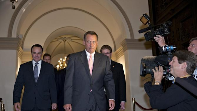 House Speaker John Boehner of Ohio departs the Capitol in Washington, Thursday, Oct. 10, 2013, en route to the White House to meet with President Barack Obama about a solution to ending the government shutdown. The federal government remains partially shut down for a 10th day and faces a first-ever default between Oct. 17 and the end of the month. (AP Photo/J. Scott Applewhite)