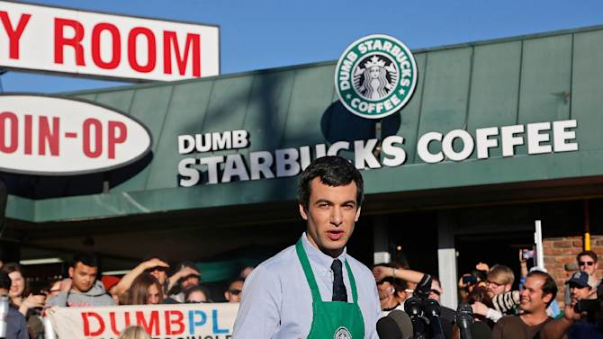 """FILE - In this Feb. 10, 2014 file photo, Canadian comedian Nathan Fielder of the Comedy Central show """"Nathan For You"""" comes forward as the brainchild of """"Dumb Starbucks,"""" a parody store that resembles a Starbucks with a green awning and mermaid logo, but with the word """"Dumb"""" attached above the Starbucks sign. Fielder who came up with the fake-store concept will discuss its origins and aftermath on the Tuesday, July 29, 2014, episode of Comedy Central's """"Nathan For You."""" (AP Photo/file)"""