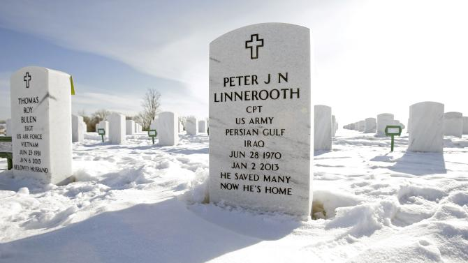 """This Feb. 15, 2013 photo shows the grave site of Capt. Peter Linnerooth at Fort Snelling National Cemetery in Minneapolis. Linnerooth's friend, Brock McNabb mulled over how to leave a legacy for his friend's kids - a memorial that would give them peace and make them proud. But he was limited to 30 characters for the message on Pete's headstone. How do you honor a life in a handful of words? McNabb then remembered something Linnerooth had once told him: """"Maybe we're all meant for just one great deed and we're done."""" (AP Photo/Jim Mone)"""