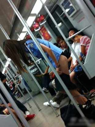 Woman seen changing her clothes on the train in Shanghai. (Screenshot from video)
