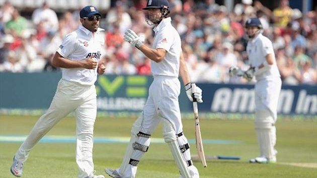 Alastair Cook, centre, progressed to 69 not out